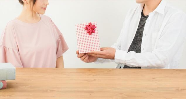 A woman giving a gift