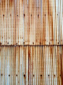 Exterior wall of tin which rusted and brown discolored due to aged deterioration