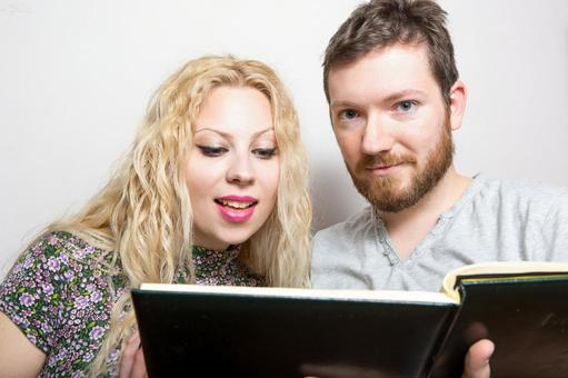 A couple reading a book