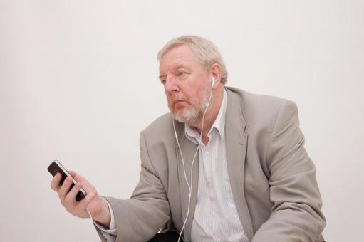 Male listening music with a smartphone 1