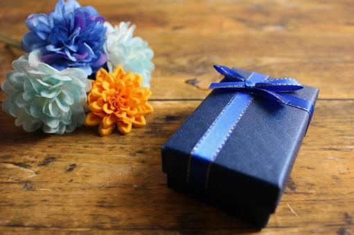 Father's Day gifts and flowers on a wooden table