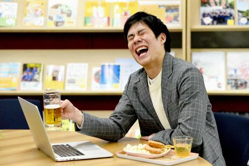 A man toasting a PC screen