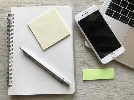 Laptop, smartphone, sticker, notebook, pen (wood grain background), remote work/telework image