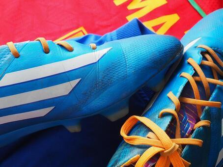 Blue soccer spikes