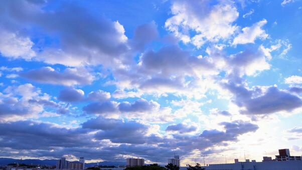 Beautiful sky background material at dusk of clouds shining in the sky Sky and clouds