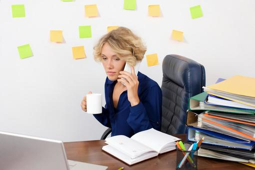 Working mother at work at the desk in front of the wall with many sticky notes 16