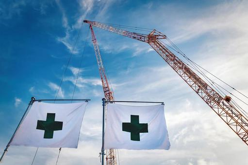 Construction site safety first green cross flag