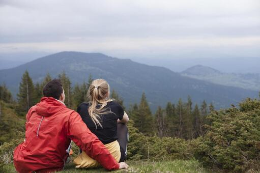 A couple sitting and watching the mountains 5