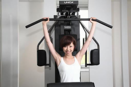 Woman using training machine 8
