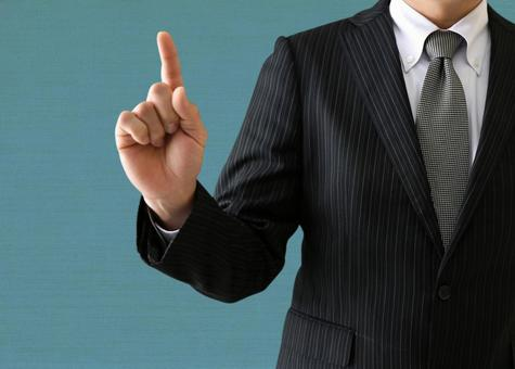 Businessman posing with hand