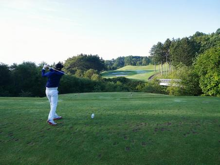 Tee shot at a golf course in the early morning when the morning sun rises Hokkaido