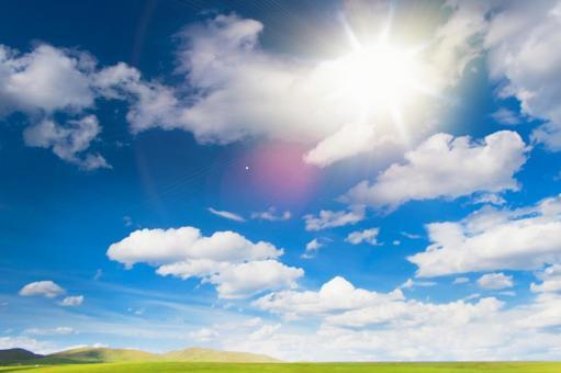 Blue sky, sun and meadow