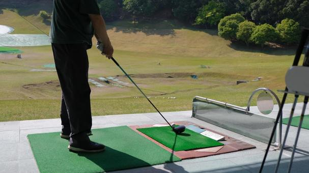 Image material of driving range Men holding a golf club (driver)