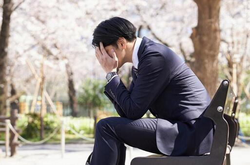 Japanese male businessman worried about worries