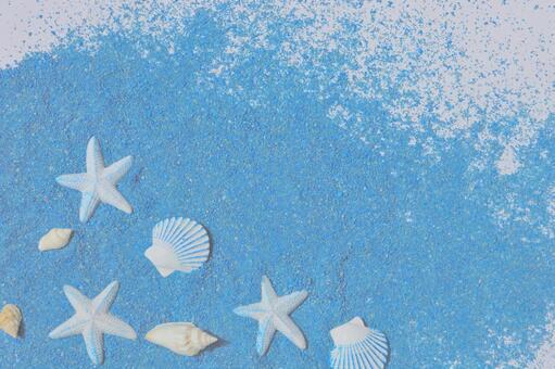 Frame of blue sand and seashells