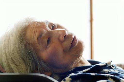 Close-up of senior woman lying in nursing bed