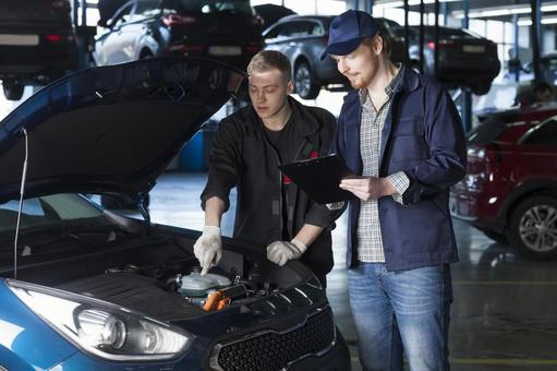 Automobile mechanic checking bonnet 17