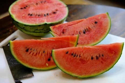 I'm cutting a small watermelon.