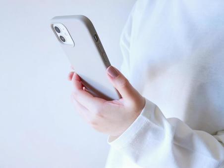 Woman touching a smartphone