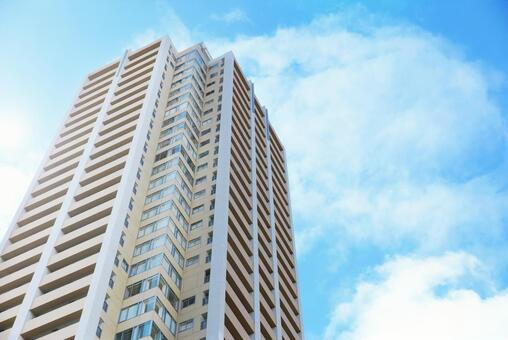 Blue sky and high rise tower apartment