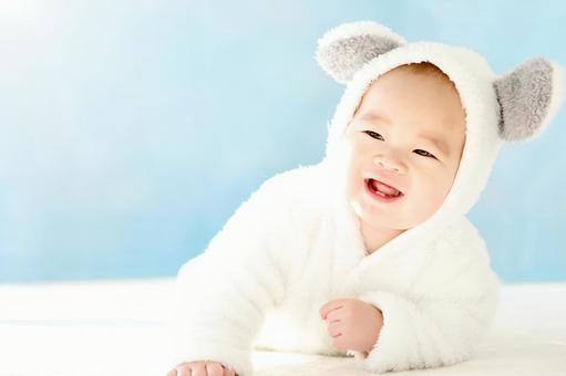 Baby cosplaying a polar bear