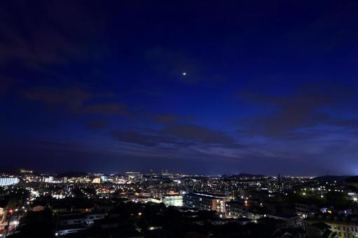 Night view of the town and moon