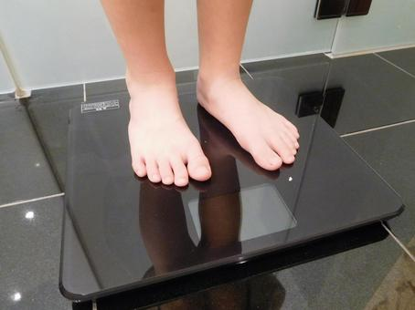 Child riding on a scale