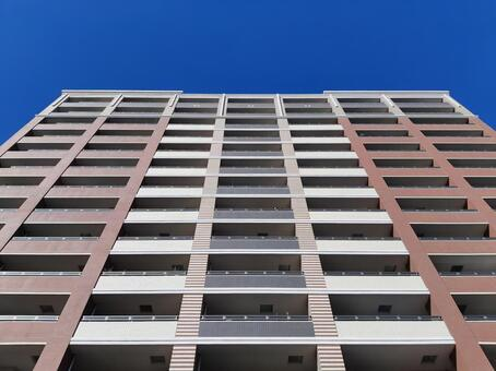 Looking up at a high-rise apartment (front)