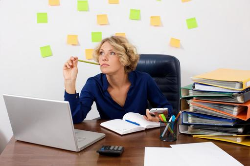 Working mother at work at the desk in front of the wall with many sticky notes 9