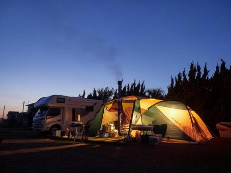 Camping tent surrounded by blue moments after sunset