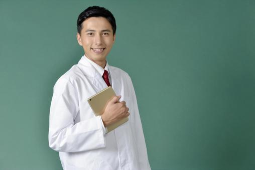 Men in a white suit with an iPad 2