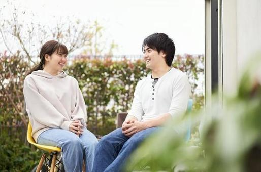 Asian couple chatting in the garden
