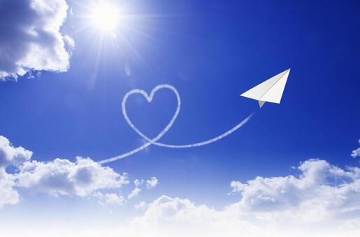 Paper airplane with heart cloud