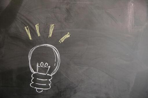 A picture of the light bulb written on the blackboard