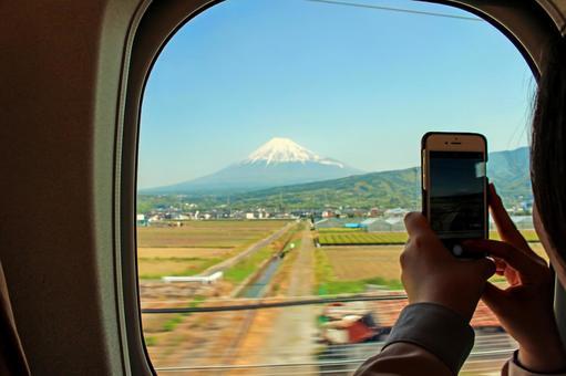 Women taking Mt. Fuji from Shinkansen