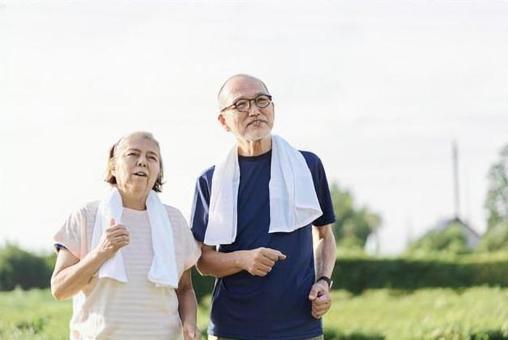 Elderly people jogging outside