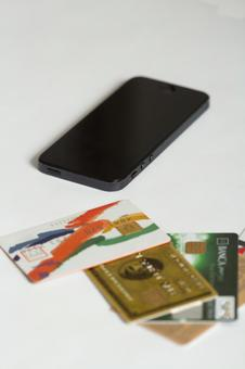 Credit card and mobile phone 1