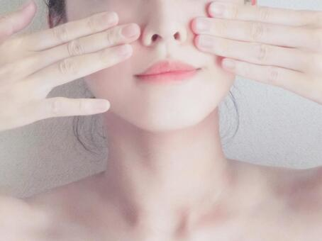 Woman doing small face massage