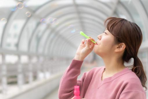 Woman playing soap bubbles