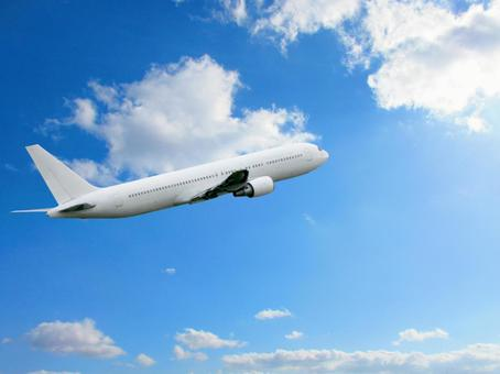 Airplane fly sunny blue sky and white clouds