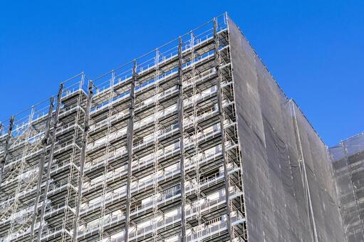 A condominium with scaffolding during large-scale repair work