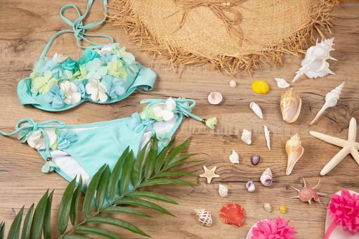 Swimsuit and straw hat Image of summer vacation and resort