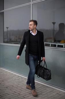 Male model 12 walking in front of the window