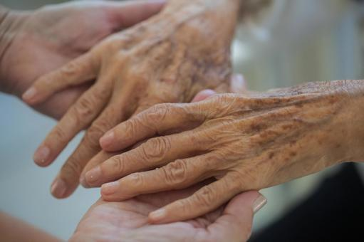 Elderly hands and supporting hands 1