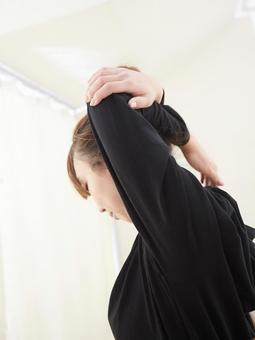 Japanese woman doing shoulder stretch