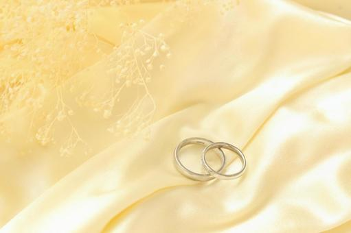 Blurred grass and wedding ring