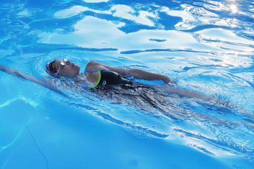 Woman backstroke in the pool 8
