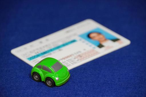 Driver's license green minicar blue background