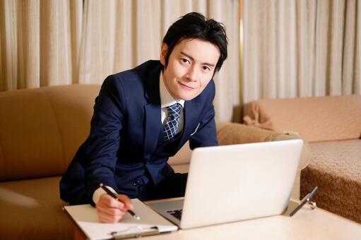 Hotel man using a laptop 19