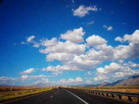 A blue sky with beautiful straight roads and clouds